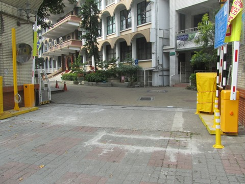 Campus space provided by Fongshan Elementary School is used as a public parking lot.
